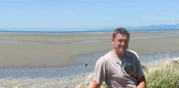 Andrew Baxter beside a whale-free Golden Bay beach.