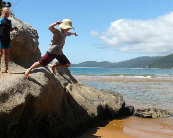 Jumping from the rocks onto the beach at Totaranui campground.