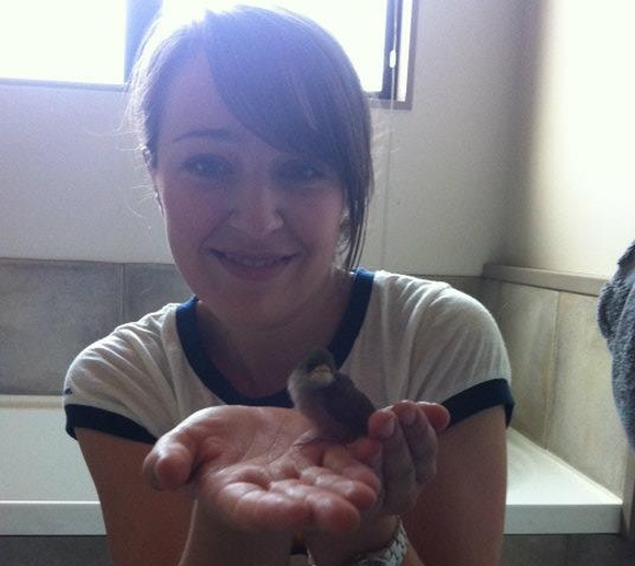 Carisse with a rescued baby silvereye.