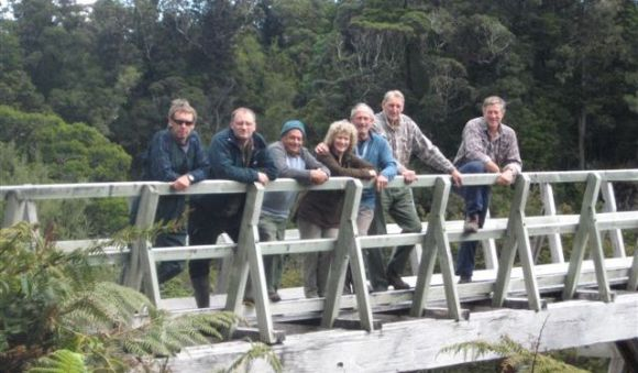 The volunteers standing on a bridge.