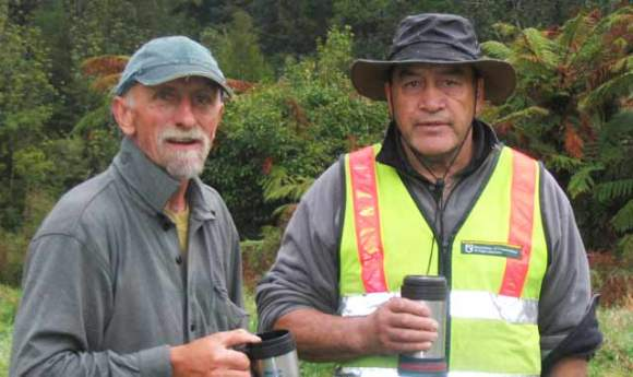 Mana and Rooster with a hot drink in the bush near Te Waiti Hut.