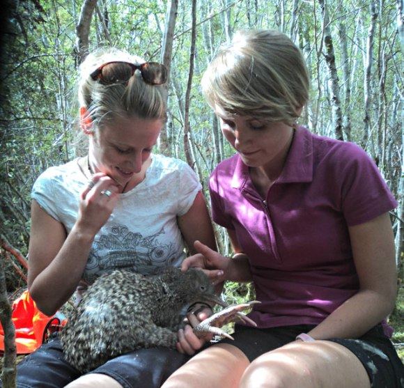 Robyn Crisford and a friend holding a kiwi.