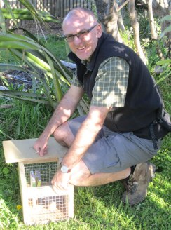 Marc setting up a DOC200 trap in the backyard.
