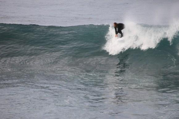 Neill Forrester surfing.