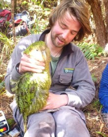 Dan Lee and Pearl the kakapo.