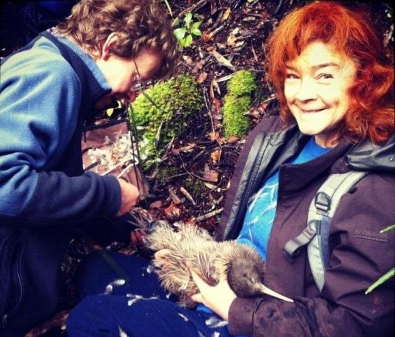 Catherine holding a kiwi at Lake Manapouri.