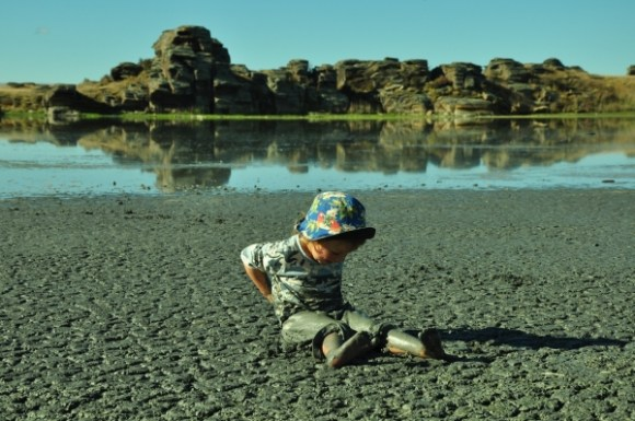 Chrissy's son Shannon playing in the silky mud.