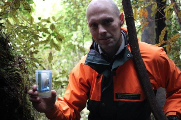 Ranger Glen Newton with the egg in a protective cup.
