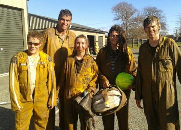 Emma and other students after a muddy fire training session at NMIT.