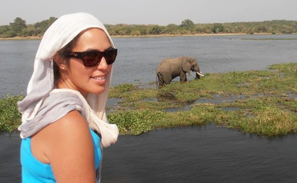 Renee with an elephant grazing in the background.