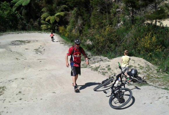 Kids on their bikes enjoying the park.