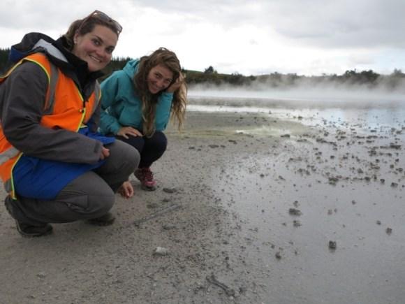 Ranger Evelien van de Ven and a visitor observing hot pools at Rotokawa.