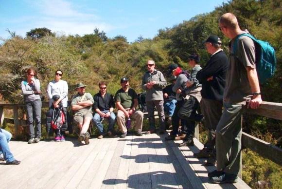 DOC staff sitting on a platform during the visit to Waimangu.