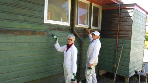 Volunteers Karen and Bob painting the DOC house.