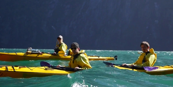 The Dive Into Adventure competition winners paddling in Milford Sound.