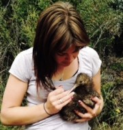 Amanda Vallis holding a kiwi.