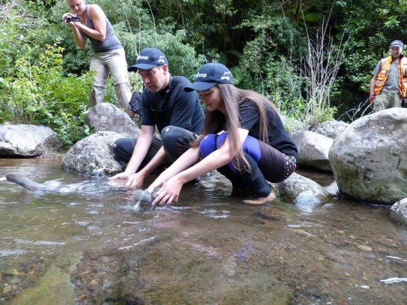Sarah and her dad releasing the whio. Photo: Sarah Ridsdale.