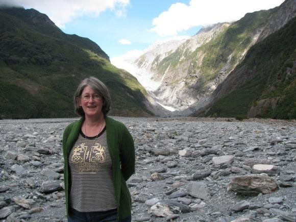 Doris standing in front of Fox Glacier.
