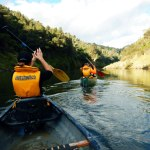 Rangers Rachael and Josh paddling the Whanganui River.