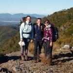 Caroline Hodges, Oonagh Daly and Moyang Li enjoying the view – Mt Stevens snail plots, Takaka. Photo DOC.