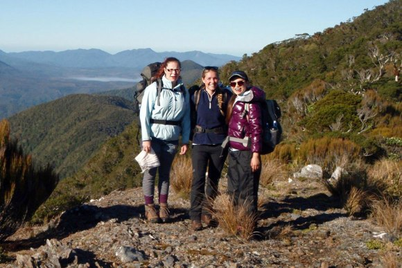 Caroline Hodges, Oonagh Daly and Moyang Li enjoying the view. Mt Stevens snail plots, Takaka. Photo DOC.