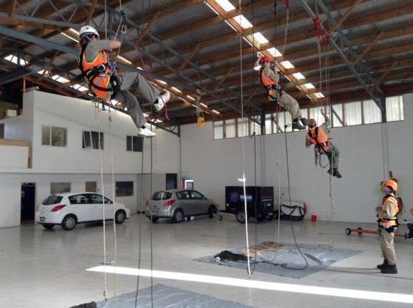 DOC staff training in the Nelson Marlborough Rescue Helicopter hangar.
