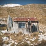 Ranger William McBeth outside Home Hill Hut.