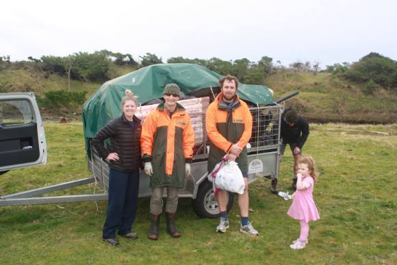 DOC staff with a trailer of rubbish collected from the beach. Photo: Taranaki Conservationists.