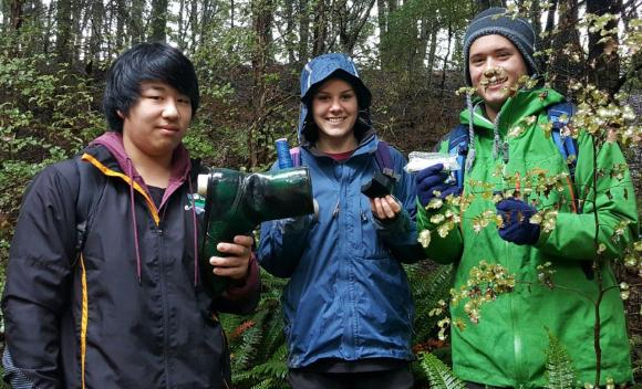 Fiordland College students holding geocaches.