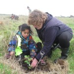 Helen Murphy planting a tree on the Chatham Islands.