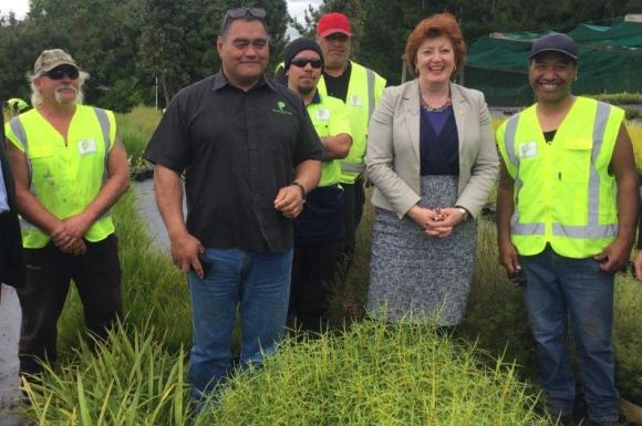 Minister of Conservation Maggie Barry with Te Whangai Trust's George Harawira and current trainees.