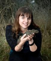 Threatened Species Ambassador Nicola Toki holding a tuatara.