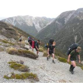 The group climbing over Armstrong Saddle.