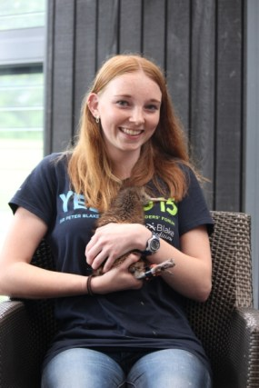 Sian holding a kiwi at Wairakei Sanctuary.