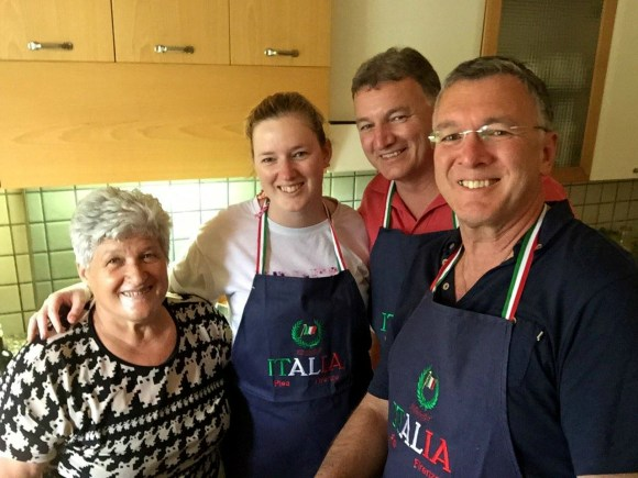 Attending an Italian cooking class in Tuscany.
