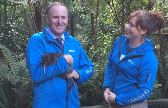 Prime Minister John Key holding Mighty Dash the kiwi.