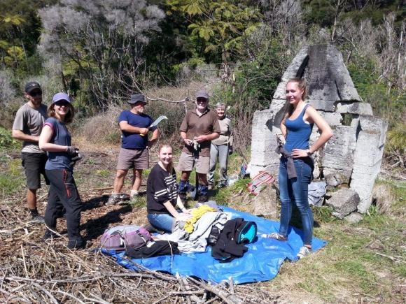 French, Belgian and German volunteers helping the Nukuhou Saltmarsh Care Group on Uretara Island. Photo: Stuart Slade.