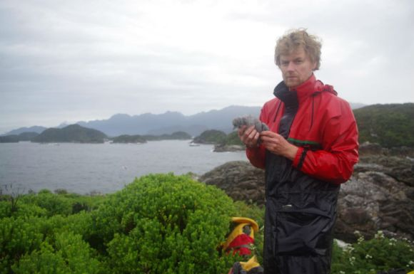 Te Papa's Alan Tennyson with a broad-billed prion chick, Seal Island. Photo: Colin Miskelly (Te Papa).