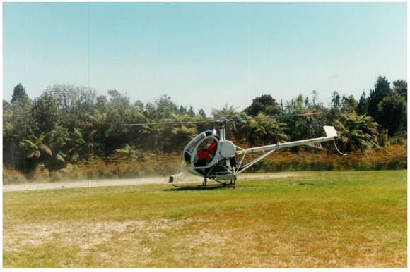 Santa arriving at early DOC Christmas Parties in a helicopter.