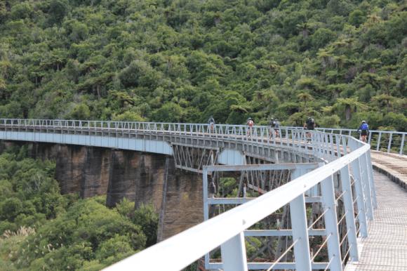 Riding across the historic Hapuawhenua Viaduct.
