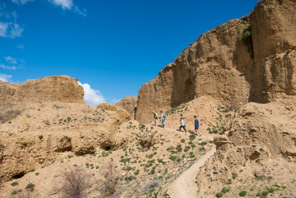 Follow the track along the cliff faces hand-work by 19th century gold miners. Photo: OneShot/Miz Watanabe