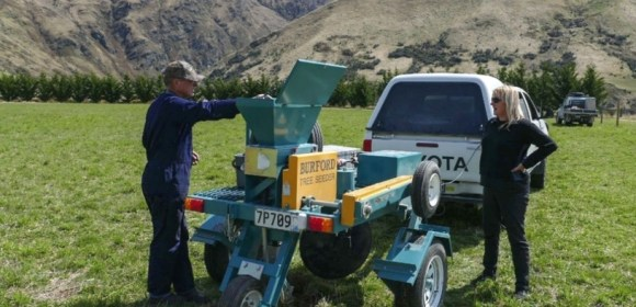 Project manager, Tim Whittaker, with the direct seeder at a site near Wanaka. Photo: Toby Jones.