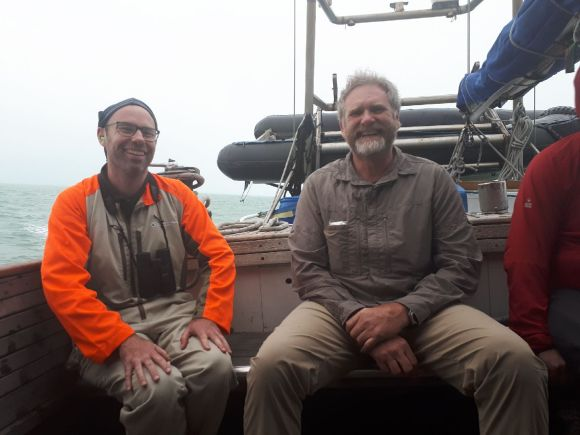 Salty sea dogs! Paul Jacques and Martin Corbett happy to finally be on their way to trap some cats. 📷: James Ware