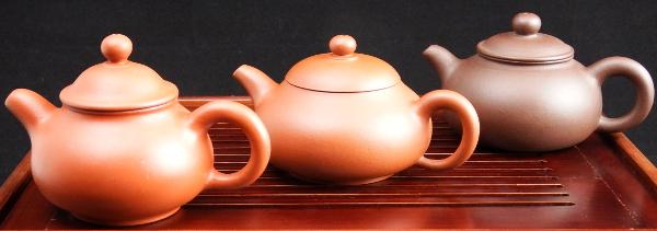 Three Yixing teapot designs.