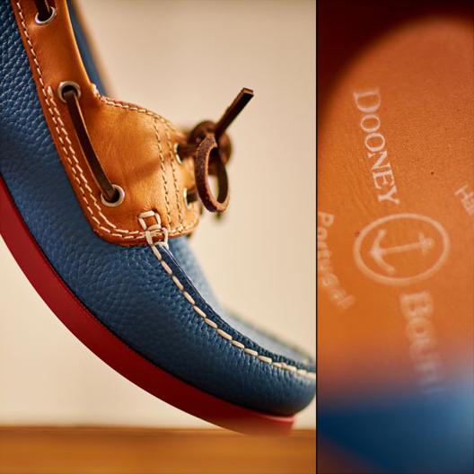 Up-close on a Dooney & Bourke boat shoe in blue.