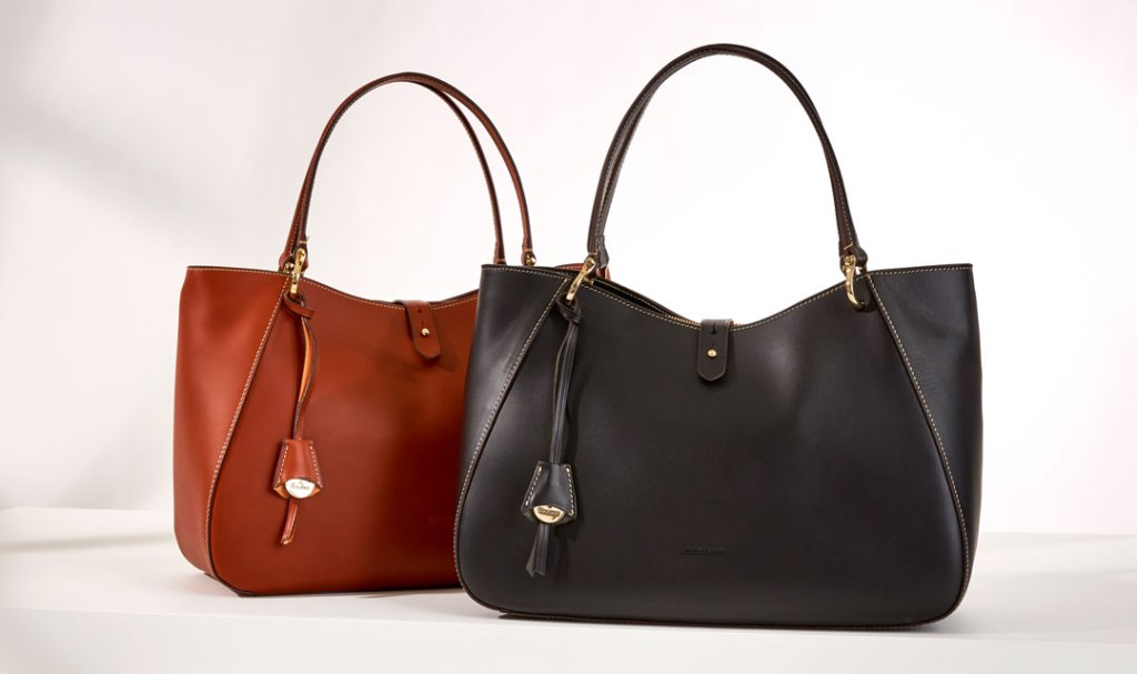 Two Alto Camilla shoulder bags, one in brown and one in black leather.
