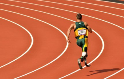 Oscar Pistorius running on the track with his specially designed running blades.