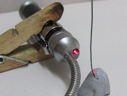 Peg holding laser and wire inserted into Blu tac.