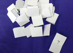 Folding the numbered pieces of paper in half will mean you can't peek, and make the numbers more random.