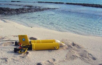 Yellow submarine on a beach.